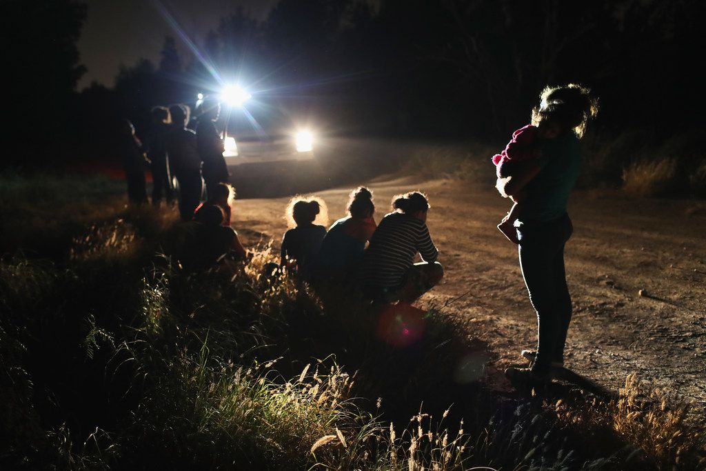 U.S. Border Patrol agents arrive to detain a group of Central American asylum seekers near the U.S.-Mexico border in McAllen. The group of women and children had rafted across the Rio Grande from Mexico and were detained before being sent to a processing center for possible separation.