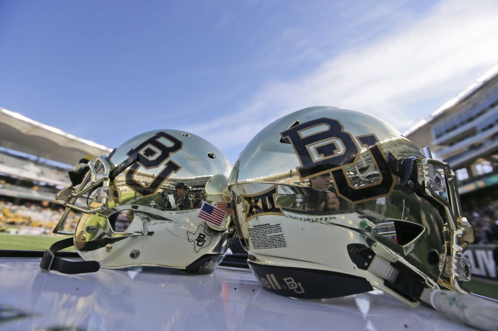 FILE - In this Dec. 5, 2015, file photo, Baylor helmets on shown the field after an NCAA college football game in Waco, Texas. Baylor University will look to rebuild its reputation and perhaps its football program after an outside review found administrators mishandled allegations of sexual assault and the team operated under the perception it was above the rules. (AP Photo/LM Otero, File)