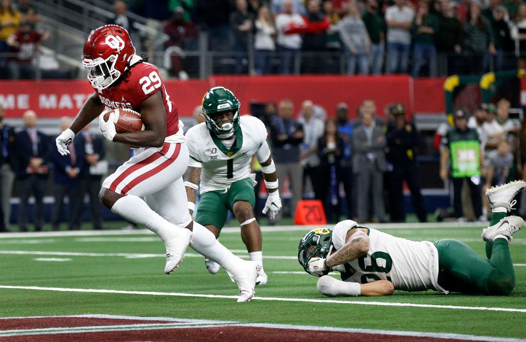 FILE - Oklahoma running back Rhamondre Stevenson (29) scores the winning touchdown in overtime to beat Baylor in the Big 12 Championship at AT&T Stadium in Arlington on Saturday, Dec. 7, 2019.