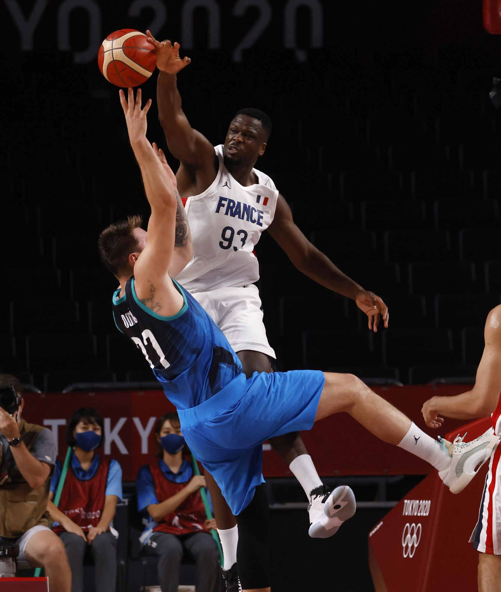 Slovenia's Luka Doncic (77) is fouled by France's Moustapha Fall (93) during the second half of a men's basketball semifinal at the postponed 2020 Tokyo Olympics at Saitama Super Arena, on Thursday, August 5, 2021, in Saitama, Japan. France defeated Slovenia 90-89. Slovenia will play in the bronze medal game. (Vernon Bryant/The Dallas Morning News)