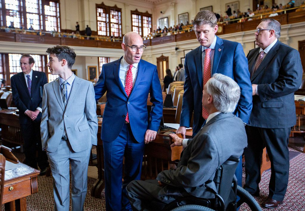 Gov. Greg Abbott (right, back to camera) chats with House Speaker Dennis Bonnen (2nd from left) and others as seen on the House floor just before Sine Die at the State Capitol of Texas on May 27, 2019 in Austin, Texas.