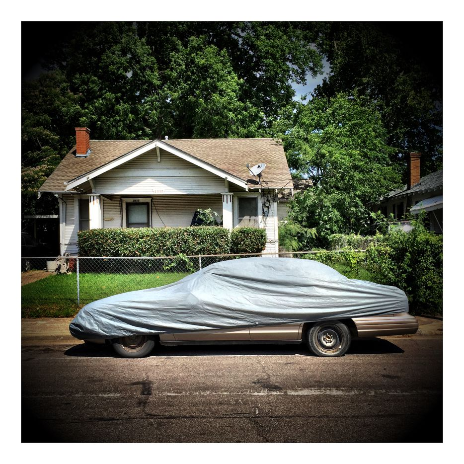 A car works undercover in South Dallas, one of many shots Guy Reynolds captured on his Meals on Wheels volunteer route.