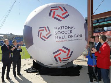 FC Dallas President Dan Hunt, from left, FC Dallas Chairman Clark Hunt, and John Harkes, far right, member of the 2005 National Soccer Hall of Fame class, and Frisco Mayor Jeff Cheney, center right, unveil the new logo for the National Soccer Hall of Fame at Toyota Stadium in Frisco, Texas on Dec. 12, 2017.