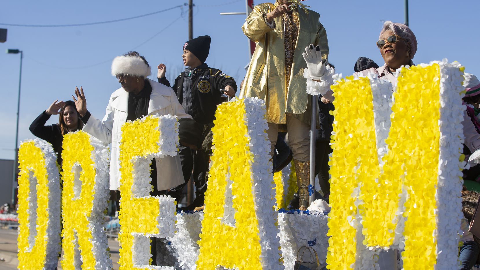 This file photo shows the MLK Board waving as they make their way down Martin Luther King Jr. Blvd during the 38th annual MLK Parade on Jan. 20, 2020 in Dallas.
