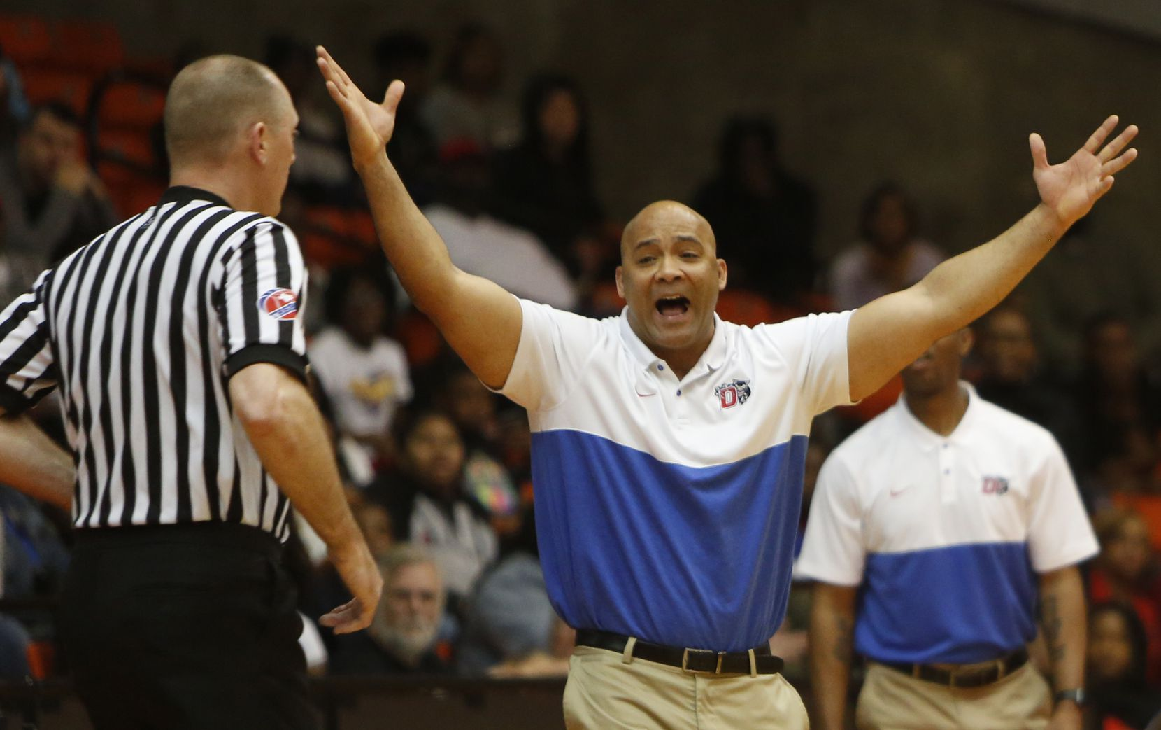 Duncanville head coach David Peavy question the lack of a call during first half action of their game against Odessa Permian. Duncanville won 59-43 to gain a berth in the UIL state tournament. The two teams played in the Class 6A Region 1 championship boys basketball playoff game at Wilkerson-Greines Activity Center in Fort Worth on March 7, 2020.