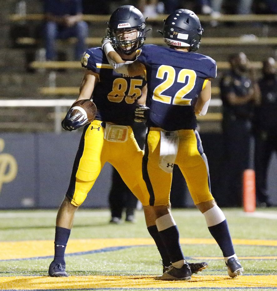 Highland Park High School wide receiver Jackson Heis (85) is congratulated by Highland Park High School wide receiver Luke Rossley (22) after Heis scored a touchdown during the second half as Highland Park High School hosted Longview High School at Highlander Stadium in Dallas on Friday night, October 8, 2021. (Stewart F. House/Special Contributor)