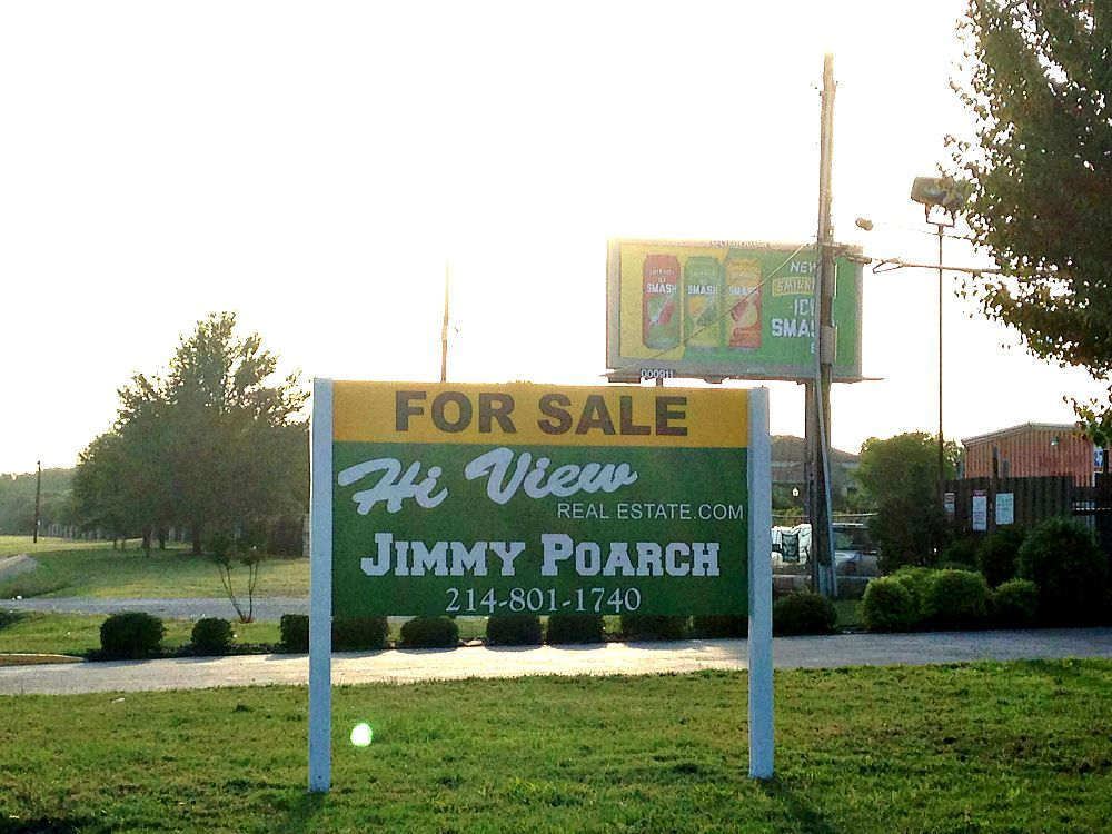 Everyone driving to or from the Nelson this weekend will see Jimmy Poarch's giant sign on the former used-car lot on Loop 12.