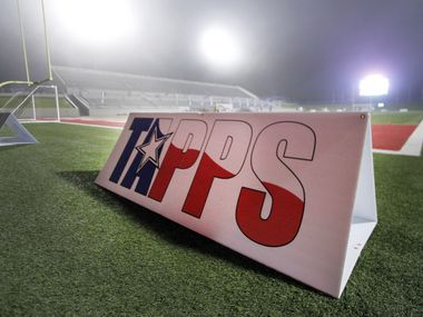 A TAPPS sign is on the field backlit from stadium lights in the fog. Ursuline defeated John Paul ll 2-0 to capture the state championship trophy. The two teams played their TAPPS Division 1 girls state soccer championship game at Waco ISD Stadium in Waco on February 23, 2018.