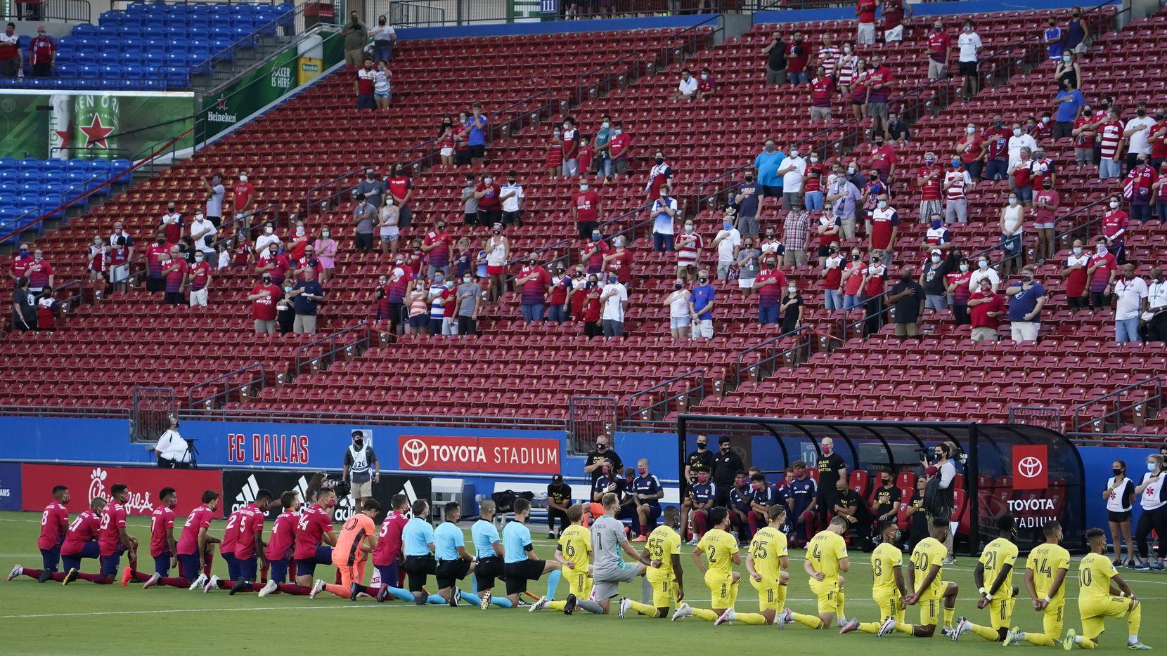 FC Dallas (left) and Nashville SC players kneel during the national anthem before an MLS soccer game at Toyota Stadium on Wednesday, Aug. 12, 2020, in Frisco, Texas. (Smiley N. Pool/The Dallas Morning News)