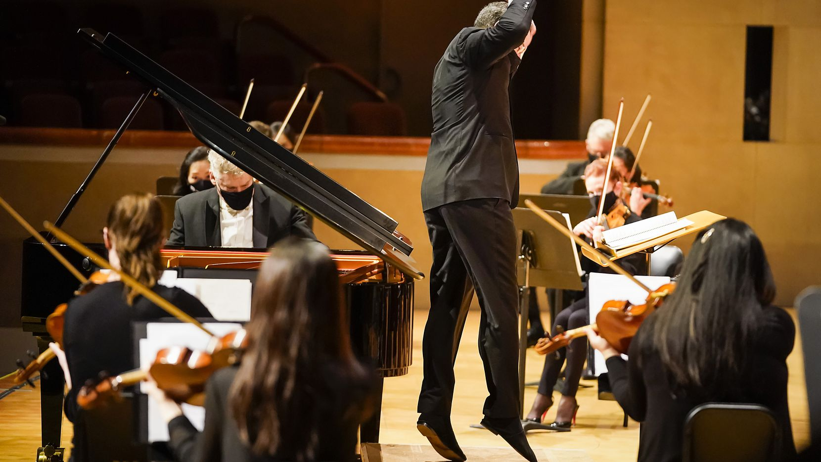 Guest conductor Andrew Grams conducts the Dallas Symphony Orchestra with pianist William Wolfram at the Meyerson Symphony Center on March 19, 2021, in Dallas.
