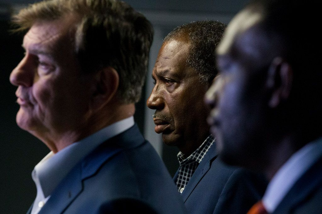 State Sen. Royce West, D-Dallas, and Dallas Mayor Pro Tem Casey Thomas listened as Mayor Mike Rawlings spoke at a news conference Saturday at Paul Quinn College.