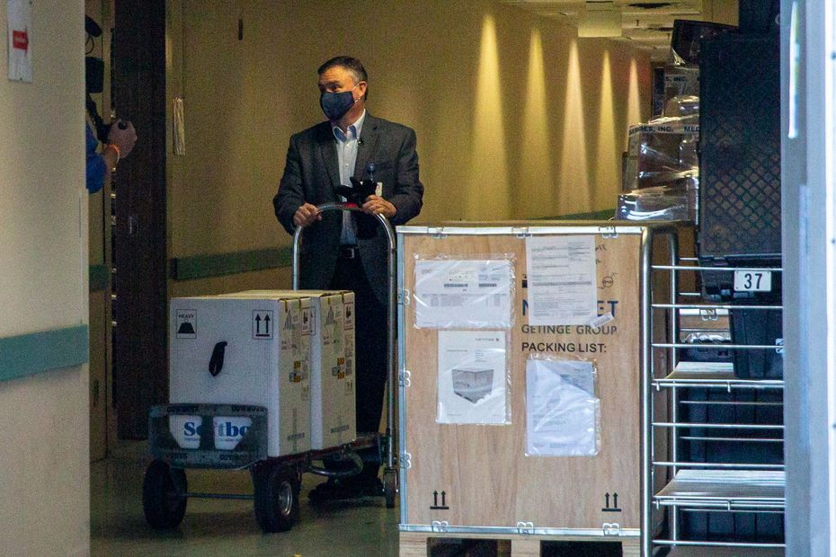 VP and Chief Pharmacy Officer Jon Albrecht receives a shipment of the Pfizer COVID-19 vaccine arriving at Methodist Dallas Medical Center in Dallas on Monday. The hospital is one of four sites across Texas receiving the shipment today.