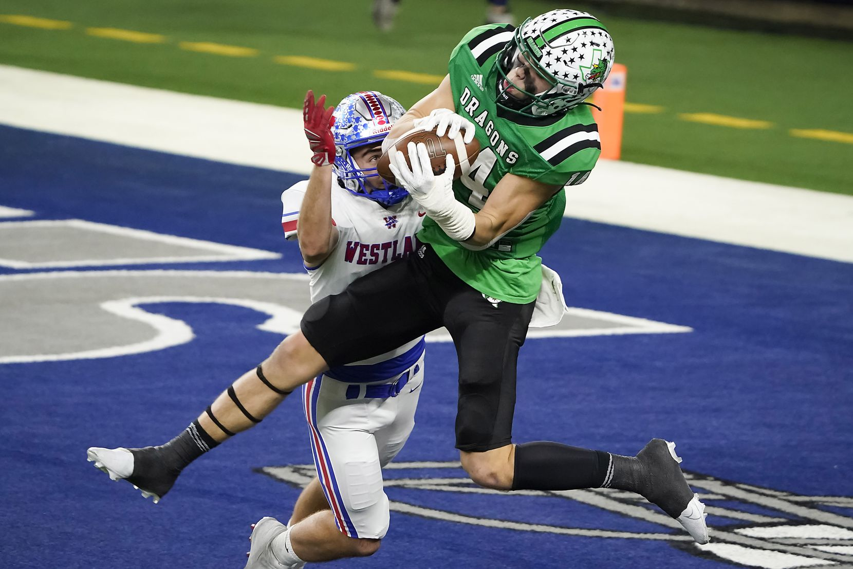 Southlake Carroll wide receiver Brady Boyd (14) catches a 27-yard touchdown pass as Austin Westlake defensive back Jax Crockett (4) defends during the second quarter of the Class 6A Division I state football championship game at AT&T Stadium on Saturday, Jan. 16, 2021, in Arlington, Texas.