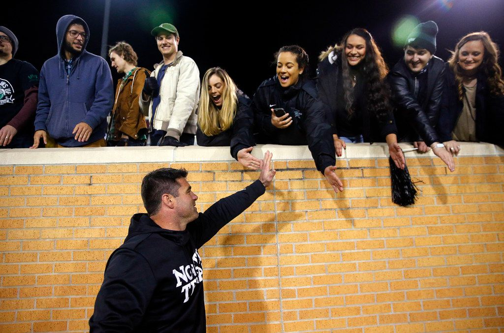 North Texas Mean Green head coach Seth Littrell slaps hands with students following their win over the Florida Atlantic Owls at Apogee Stadium in Denton, Texas, Thursday, November 15, 2018. (Tom Fox/The Dallas Morning News)