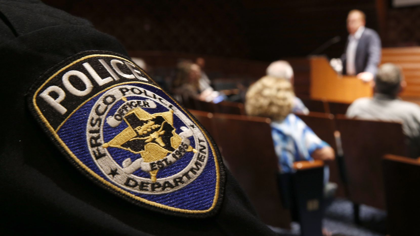 Frisco police chief John Bruce (not seen listens to Mayor Jeff Cheney talks about safety improvements in the school district at Frisco City Hall in Frisco, Texas on April 13, 2018.  (Nathan Hunsinger/The Dallas Morning News)