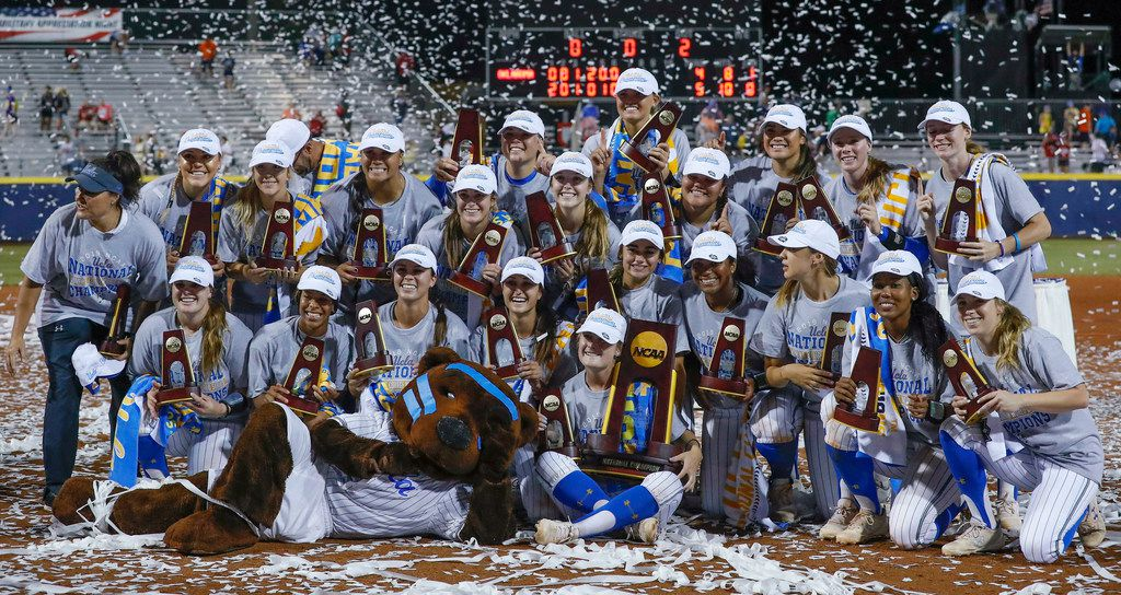 The UCLA team poses for photos after defeating Oklahoma in the NCAA softball Women's College World Series in Oklahoma City, Tuesday, June 4, 2019. UCLA won 5-4 in Game 2, taking both games in the best-of-three series. (AP Photo/Alonzo Adams)