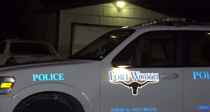 A Fort Worth police vehicle sits outside a home where a man was fatally shot Tuesday night.