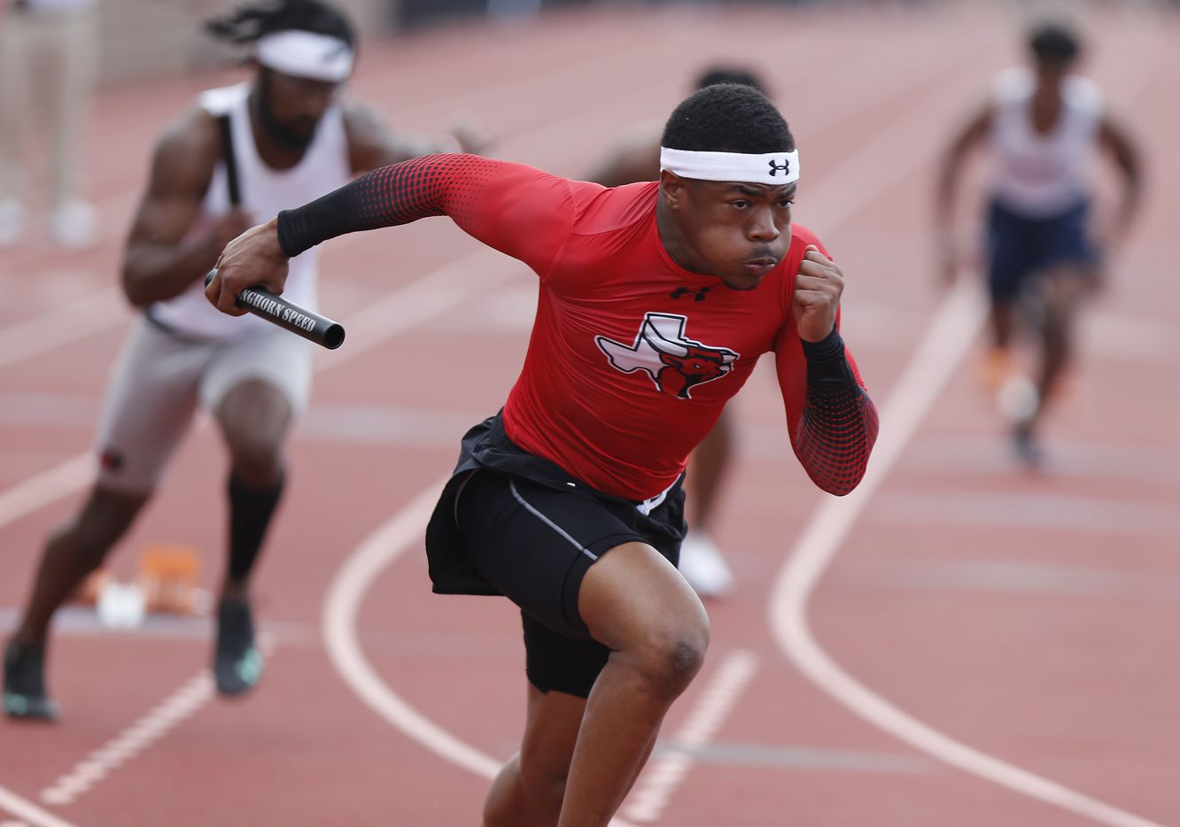 Kaleb Green, 17, begins the first leg of the boys 4 x100 for Lancaster High School during the Jesuit-Sheaner Relays held at Jesuit College Preparatory School in Dallas on Saturday, March 27, 2021.  (Stewart F. House/Special Contributor)