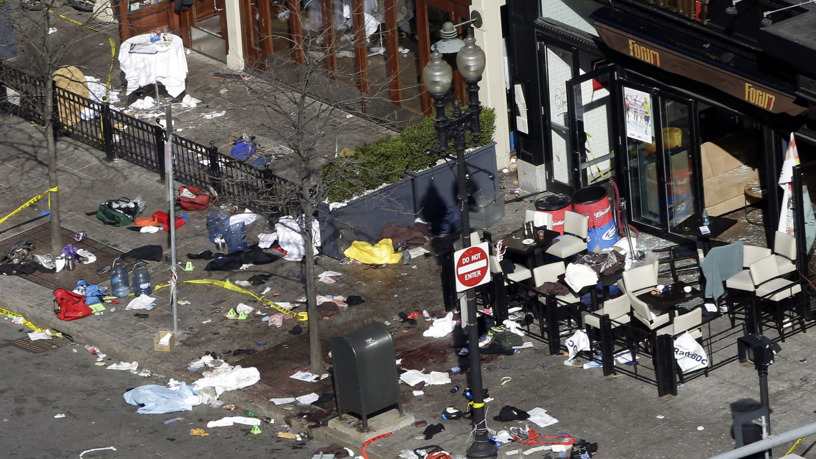 Debris litters the sidewalk at the scene of one of the explosions near the finish line of the Boston Marathon.