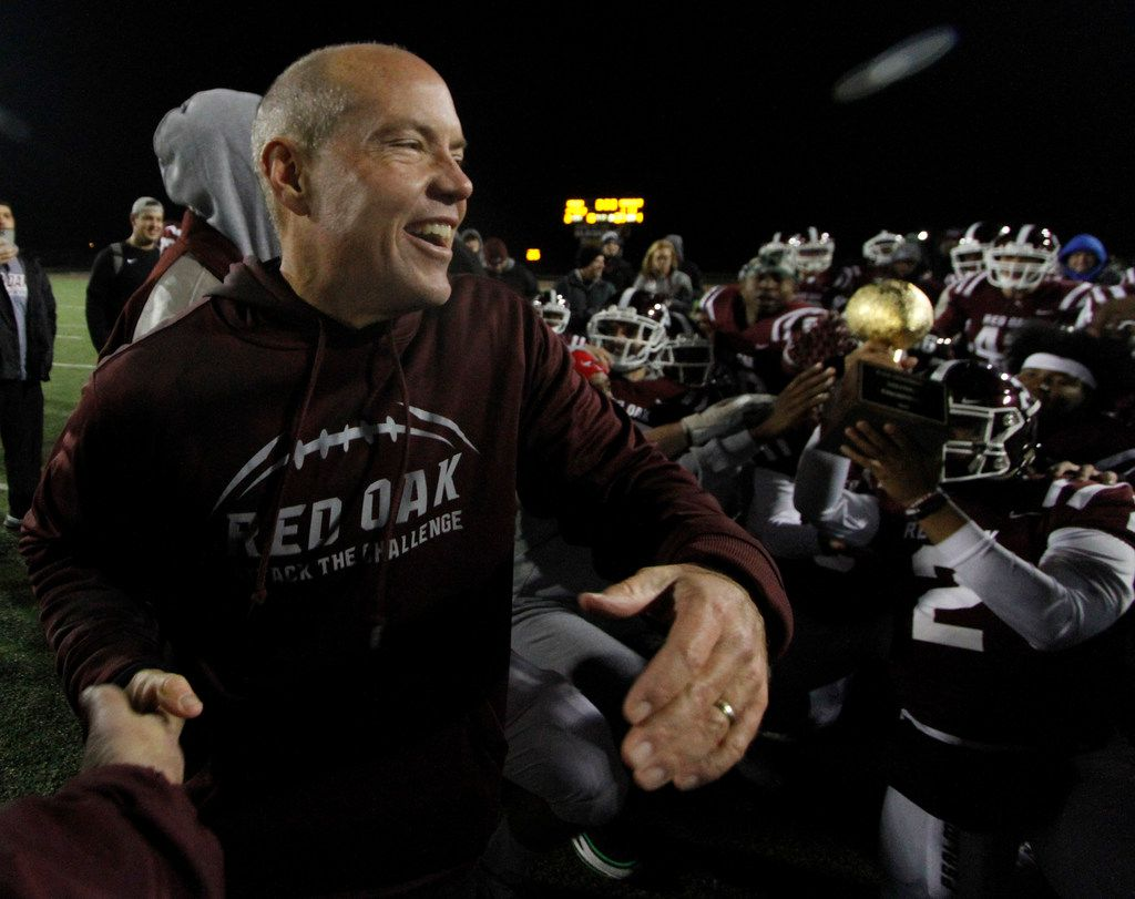 Red Oak head coach Chris Ross was all smiles as he celebrates with his players at midfield after being presented with the district trophy following their 48-13 victory over Seagoville. The two teams played District 6-5A Division ll football game at Billy Goodloe Stadium in Red Oak on November 7, 2019. (Steve Hamm/ Special Contributor)