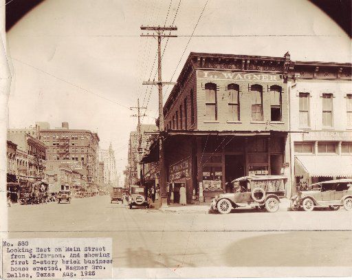 Looking east on Main Street from Jefferson, showing first two-story brick business erected, Wagner Grocery, Dallas, Texas, August 1925 / note: Charles Arthur surveyor - A. Zeese Engraving Co. - Roos, Freedman, Shayne Co.  HARD COPY LOCATION: DALLAS - TEXAS - STREETS - MAIN