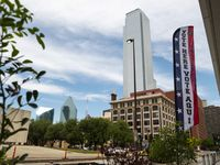 Signs mark an official polling location outside the George Allen Courts building in Downtown Dallas, during the first day of early voting, on Monday, April 19, 2021.