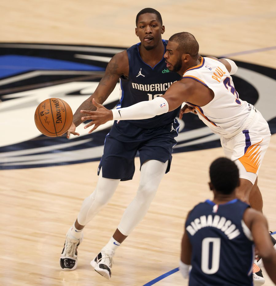 Dallas Mavericks forward Dorian Finney-Smith (10) passes to Dallas Mavericks guard Josh Richardson (0) as Phoenix Suns guard Chris Paul (3) defends during the second quarter of play at American Airlines Center on Monday, February 1, 2021in Dallas. (Vernon Bryant/The Dallas Morning News)