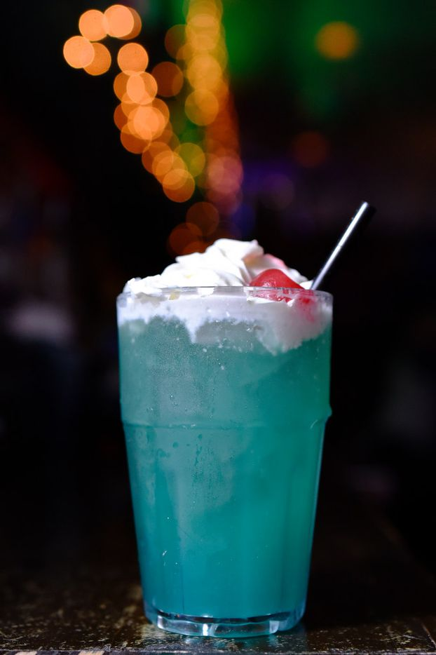 Stewie's Cool Hwhip, made with rum, blue curaçao, cruzan coconut rum, pineapple juice and topped with whip cream, served at the Drunken Clam, Thursday night Jan. 10, 2019 in Dallas. Drunken Clam is themed after the bar in Family Guy. Ben Torres/Special Contributor