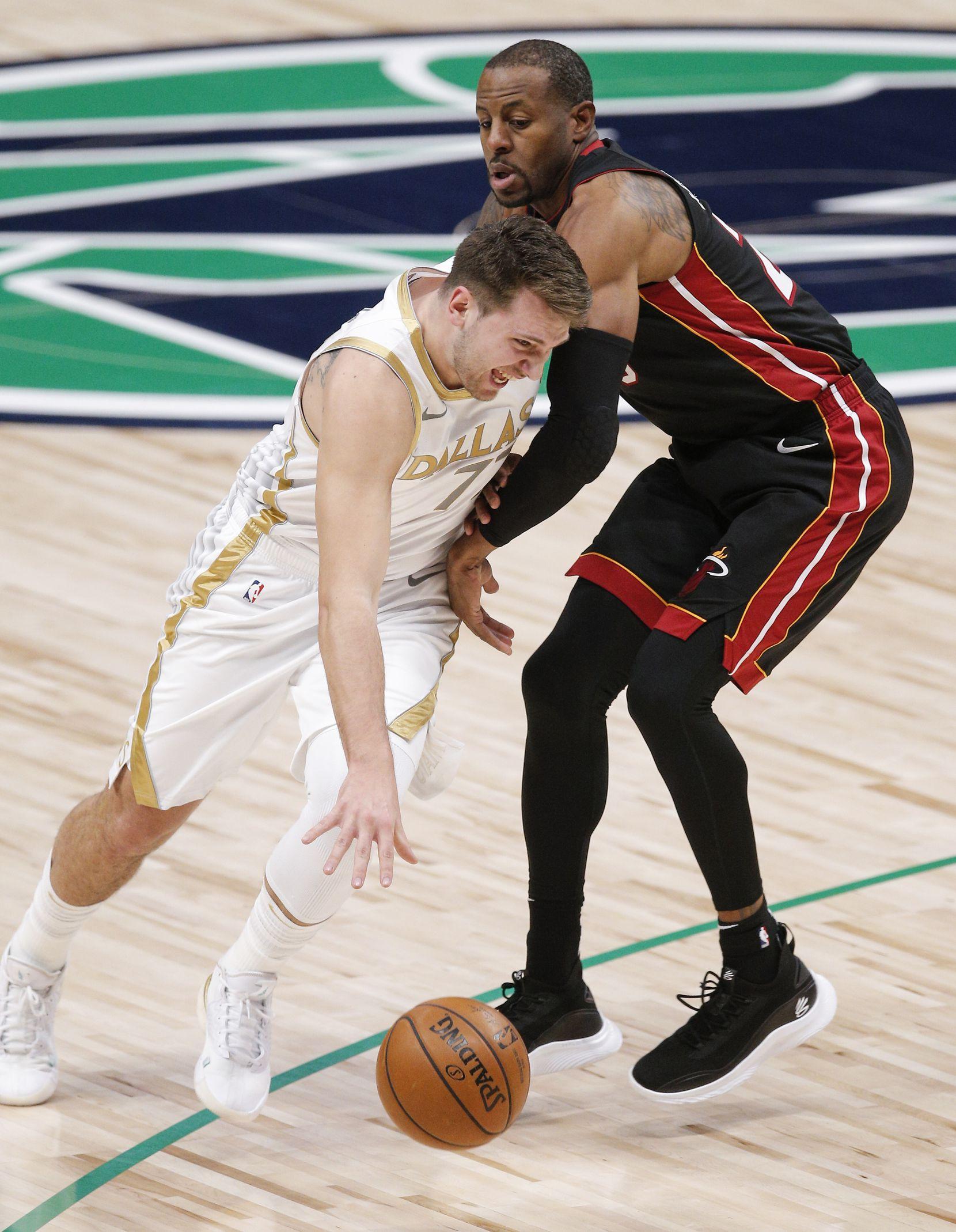 Dallas Mavericks guard Luka Doncic (77) battles Miami Heat guard Andre Iguodala (28) for space during the first half of an NBA basketball game, Friday, January 1, 2021. (Brandon Wade/Special Contributor)