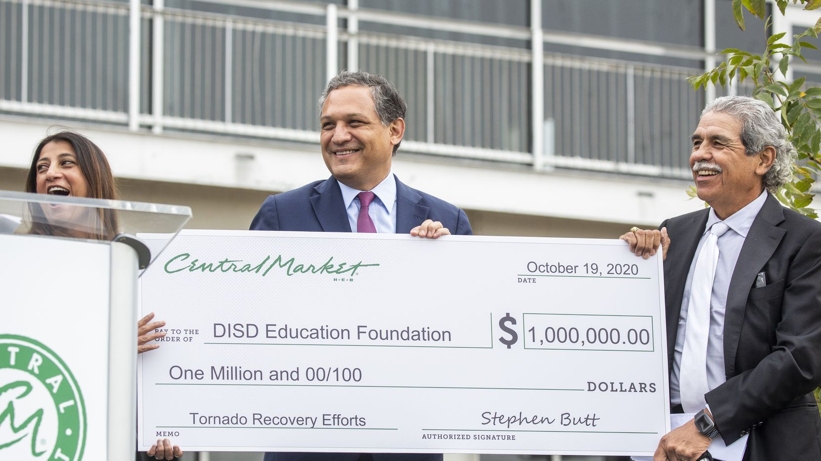 From left, Mita Havlick, executive director of Dallas Education Foundation, Edwin Flores, Dallas ISD Board Trustees for District 1, and Dr. Michael Hinojosa (right), superintendent of Dallas ISD, react to receiving a $1 million check during a ceremony announcing charitable donations for tornado rebuilding projects at the Central Market Preston Royal location in Dallas on Monday, Oct. 19, 2020. H-E-B/Central Market made a $1 million donation to Dallas ISD's Dallas Education Foundation on Monday, while also gifting 50 trees and announcing an April/May 2021 completion date for its Preston Royal store reopening after a tornado tore through the area a year ago. (Lynda M. González/The Dallas Morning News)
