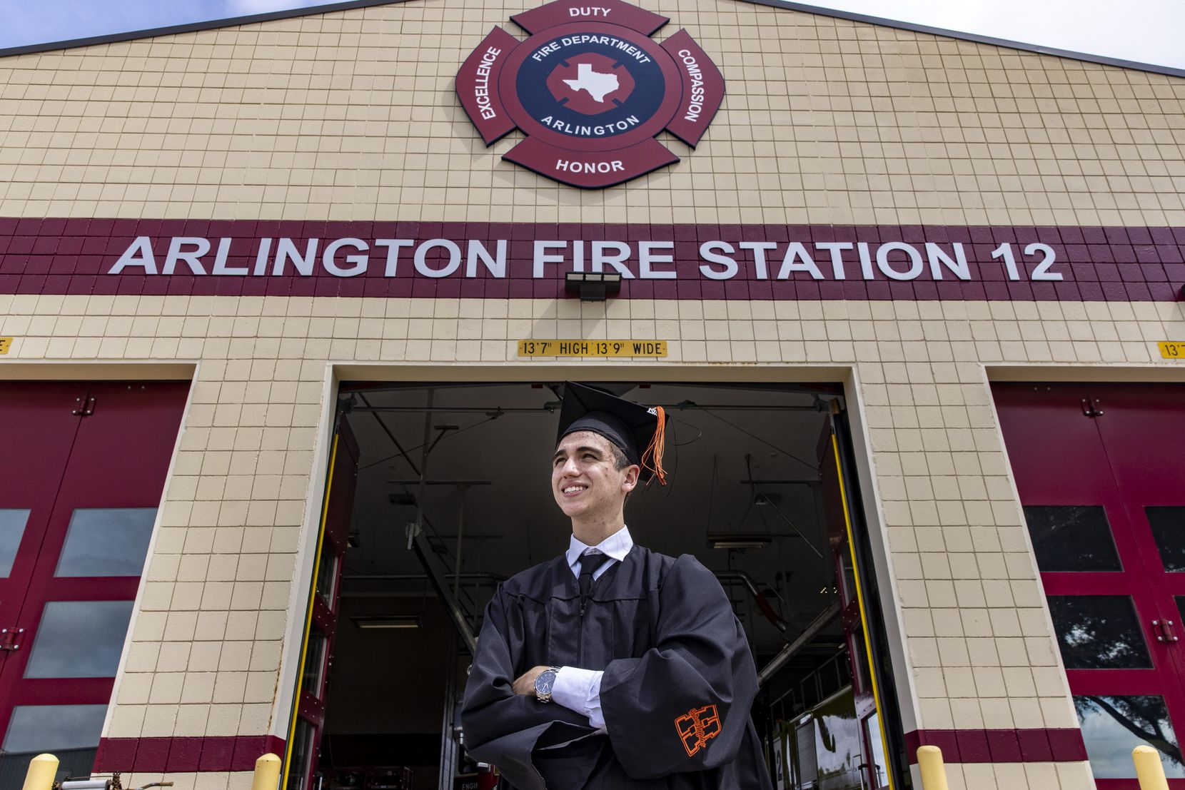 """Koregan Quintanilla, standing in front of Arlington Fire Station 12, said he sometimes wonders about his birth parents. """"It's weird to think there's someone out there with a biological connection, because I truly feel like I grew up with my family."""""""