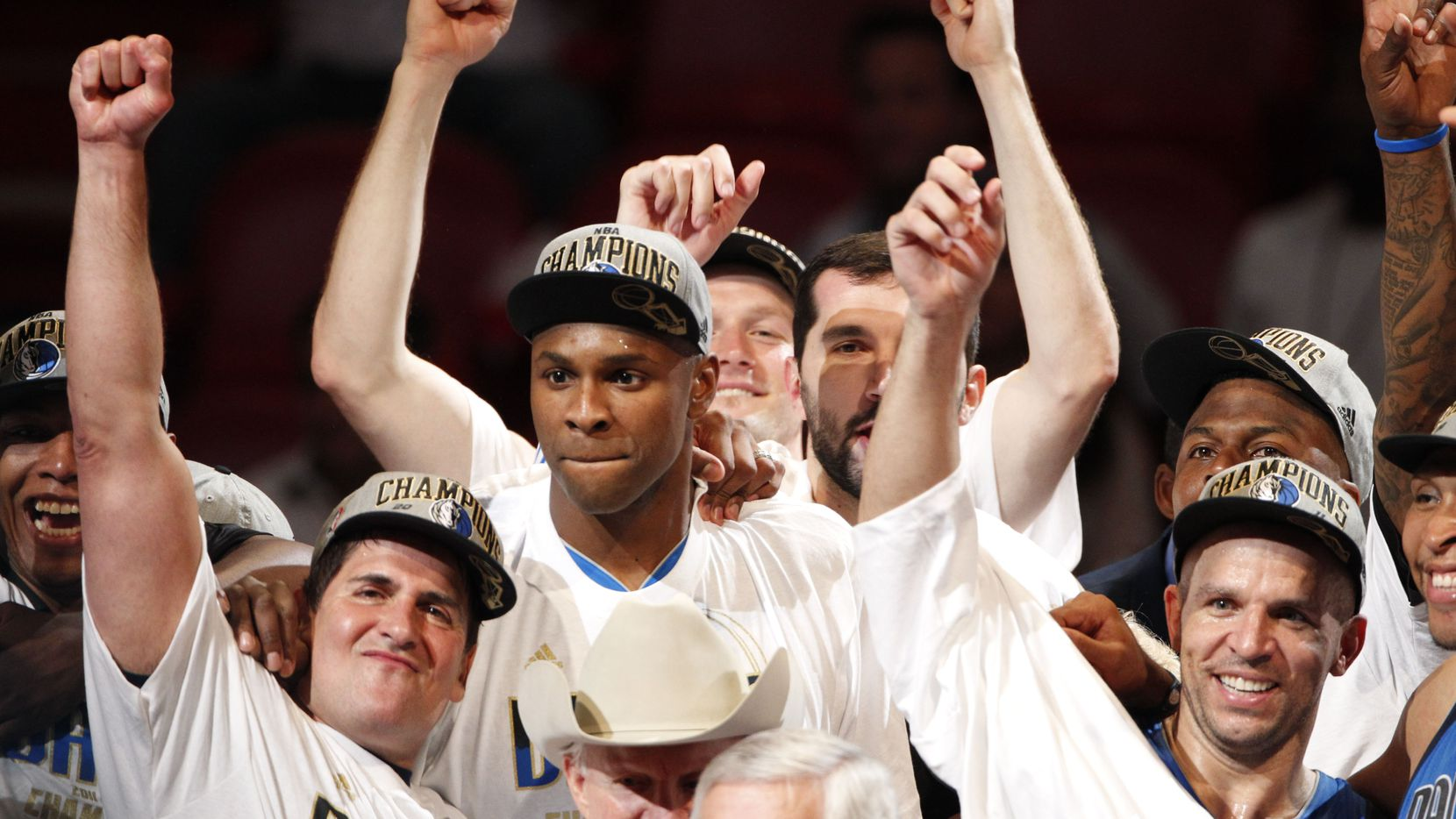 The Dallas Mavericks - including team owner Mark Cuban (bottom left), Brendan Haywood (above Cuban), Dallas Mavericks point guard Jason Kidd (2) (bottom right) and others celebrate after the Mavs won the NBA Championship by winning game six of the NBA Finals between the Miami Heat and the Dallas Mavericks at the American Airlines Arena in Miami, Florida, June 12, 2011. The Mavericks won 105-95 to take the title.