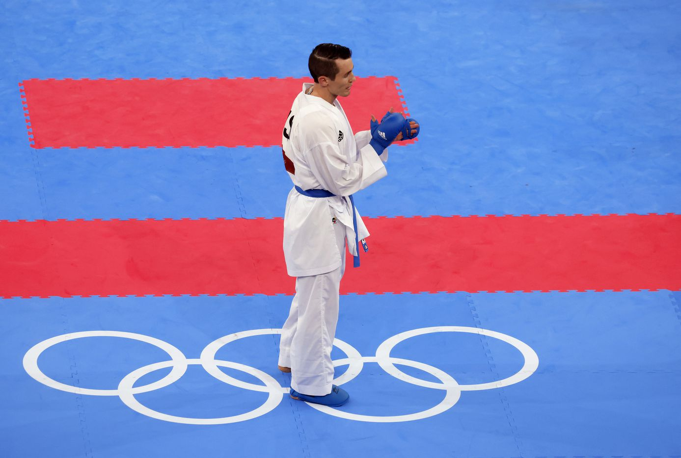 USA's Tom Scott claps after defeating Egypt's Abdalla Abdelaziz during the karate men's kumite -75kg elimination round at the postponed 2020 Tokyo Olympics at Nippon Budokan, on Friday, August 6, 2021, in Tokyo, Japan. Scott defeated Abdelaziz 7-6. Scott finished in fourth place in his pool and did not advance to the next round. (Vernon Bryant/The Dallas Morning News)