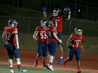 John Paul II Jerand Bradley (9) celebrates a touchdown reception with Zeke Skinner (58) against Nolan during the first half of their TAPPS Division I second-round high school football playoff game in Grapevine, Tx, Friday, Nov. 22, 2019. (Michael Ainsworth)