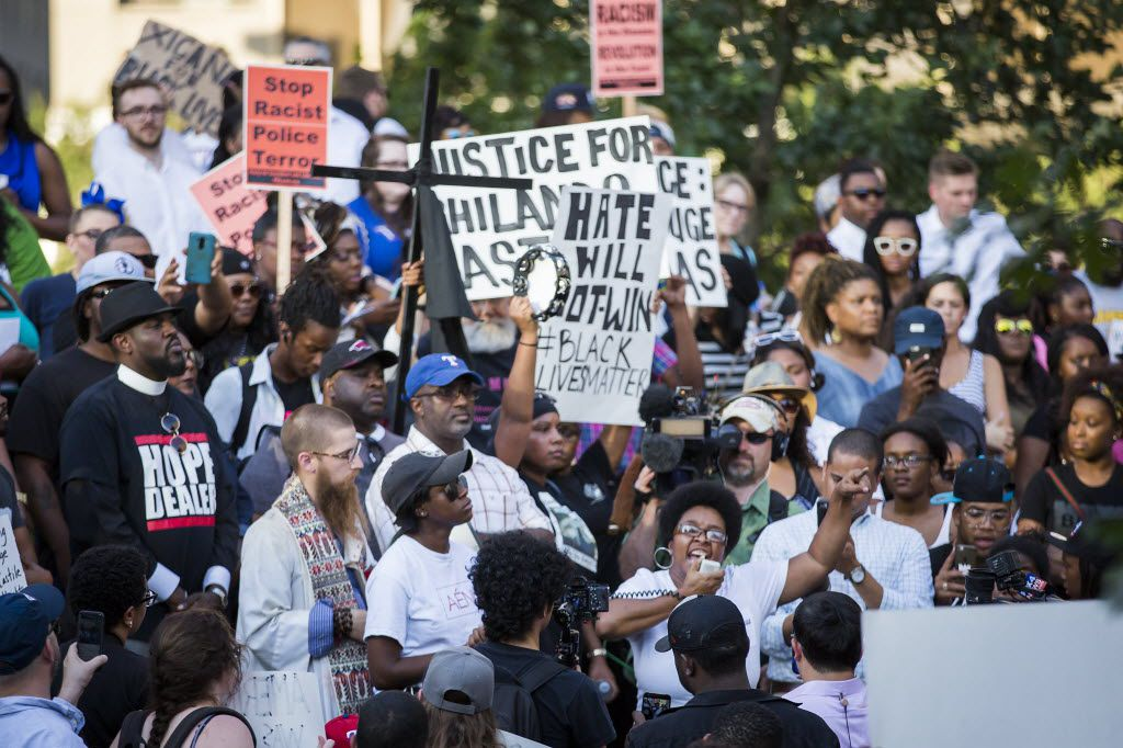 Olinka Green speaks while surrounded by protestors at a rally in downtown Dallas on Thursday, July 7, 2016. Dallas protestors rallied in the aftermath of the killing of Alton Sterling by police officers in Baton Rouge, Louisiana and Philando Castile, who was killed by police less than 48 hours in Minnesota. (Smiley N. Pool/The Dallas Morning News)