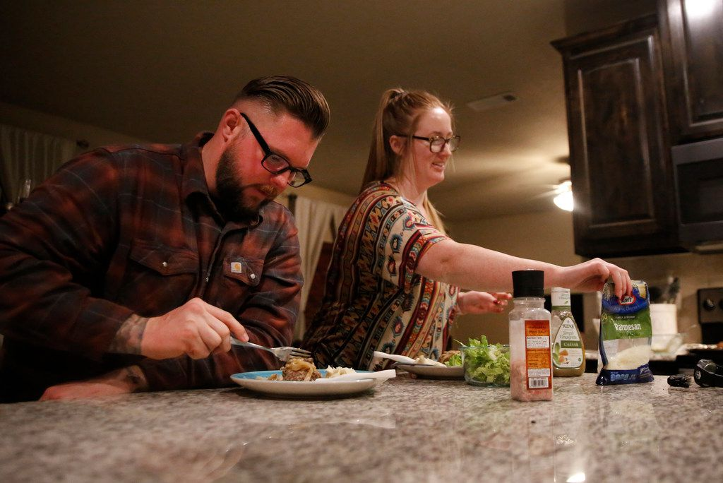 Edward Huth, a Marine veteran and federal corrections officer, eats dinner with his wife, Alanna Huth, at their home in Johnson County. He is among the 36,000 federal workers in Texas who are working without pay during the partial government shutdown.