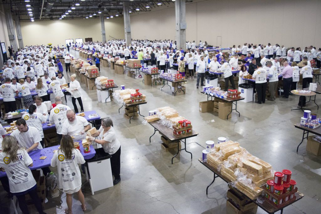 Over 700 volunteers gathered in the Gaylord Texan Convention Center to help create 39000 PB&J sandwiches for charities to hand out around North Texas.