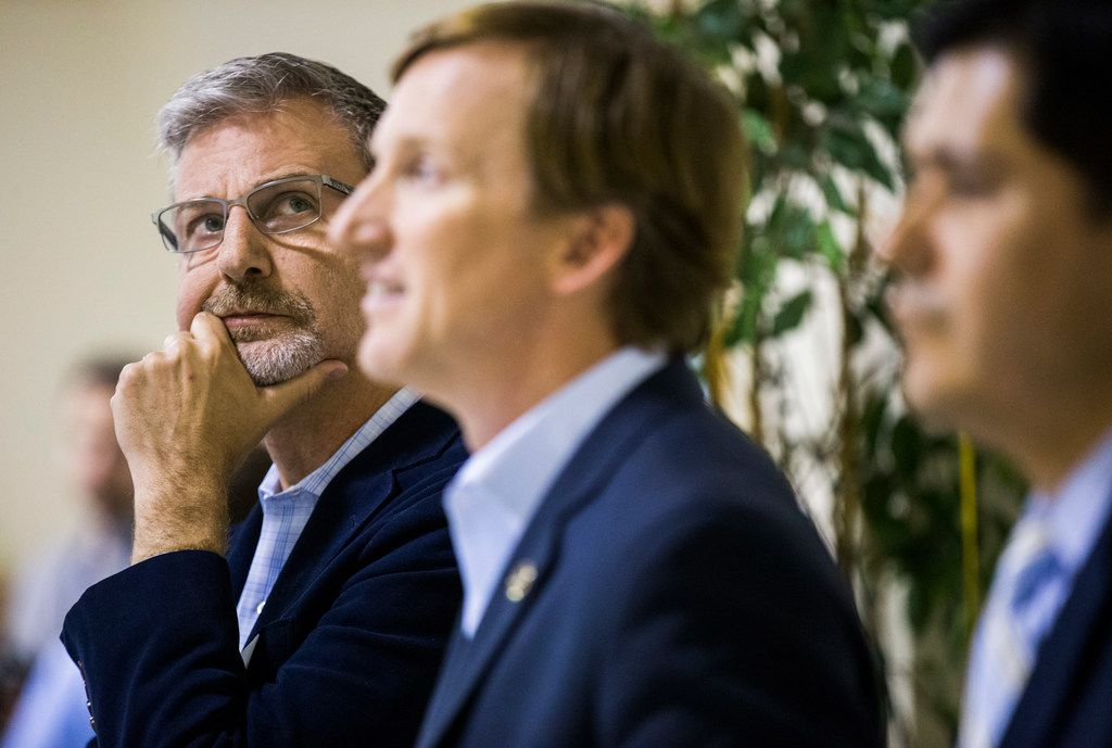 Gubernatorial candidate Jeffrey Payne, left, looks up as he, Andrew White, center, Adrian Ocegueda and other candidates wait to be introduced at The Mid-Cities Democrats Gubernatorial Forum and Chili Dinner on Tuesday, February 6, 2018 at the UAW 218 Union Hall in Hurst, Texas. (Ashley Landis/The Dallas Morning News)