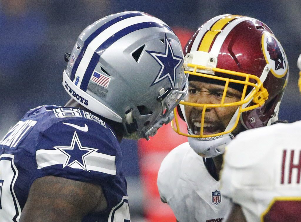 Dallas Cowboys wide receiver Dez Bryant (88) and Washington Redskins cornerback Josh Norman (24) exchange words in the fourth quarter during the Washington Redskins vs. the Dallas Cowboys NFL football game at AT&T Stadium in Arlington, Texas on Thursday, November 24, 2016. (Louis DeLuca/The Dallas Morning News)