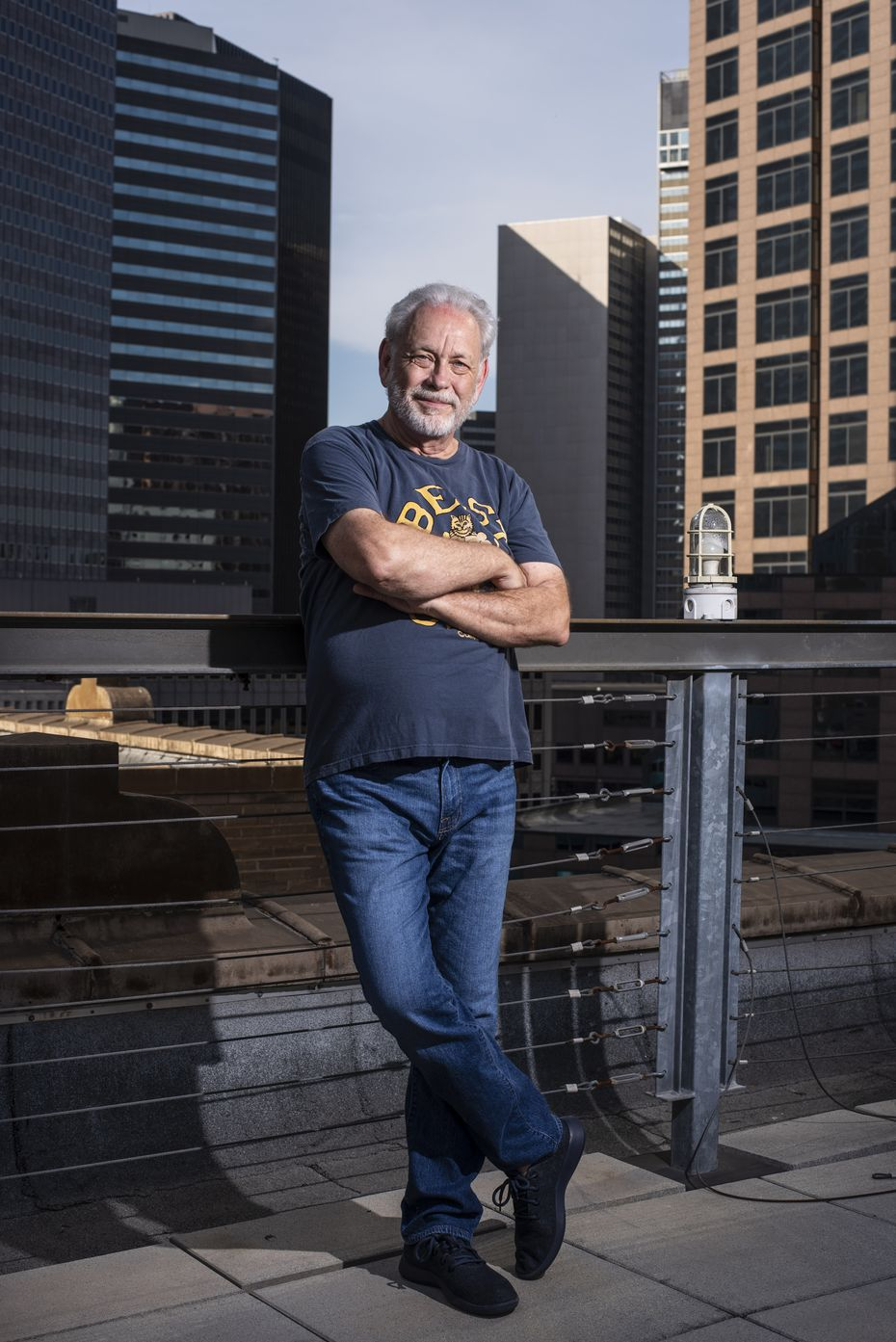 """Mike Rhyner, photographed on the rooftop of The Wilson building, walks downtown's streets daily. His assessment: """"It's pretty close to a ghost town."""""""