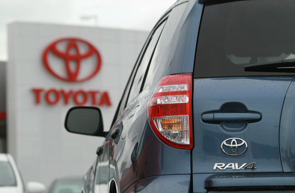 A Toyota RAV4 sits on the sales lot at a Toyota dealership in Oakland, California. (Photo by Justin Sullivan/Getty Images)