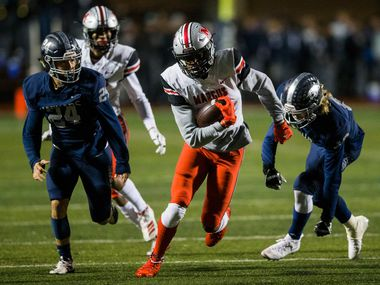 Flower Mound Marcus wide receiver J. Michael Sturdivant (7) runs the ball during the first quarter of a District 6-6A high school football game between Flower Mound Marcus and Flower Mound on Friday, October 25, 2019 at Neil E. Wilson Stadium in Flower Mound.