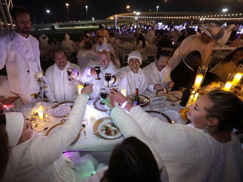 Guests enjoy a secret Diner en Blanc event at Reunion Park in Dallas on Nov. 9, 2018.