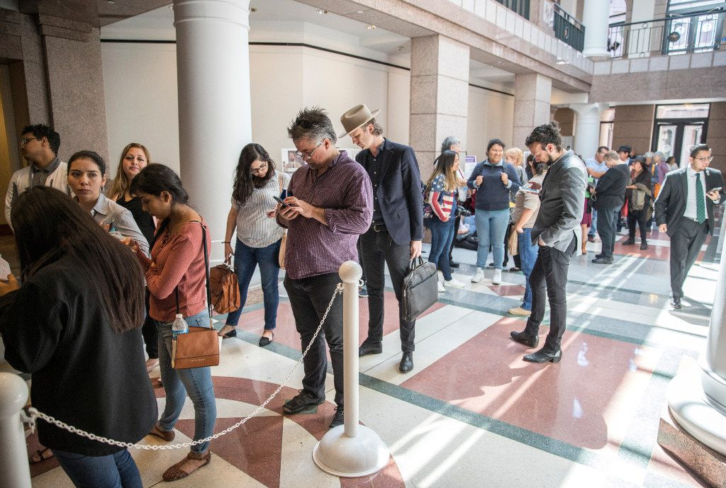 A large group of people wait in line to attend the sanctuary cities meeting in one of the hearing meeting rooms at the Texas State Capitol, Wednesday, March 15, 2017, in Austin, Texas. (Ricardo B. Brazziell/Austin American-Statesman via AP)