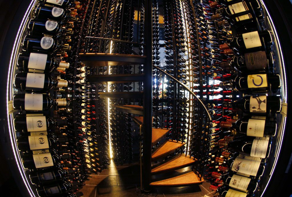 A circular wine tower cooler (as pictured with a fisheye lens) houses over 2000 bottles at the new Del Frisco's Double Eagle Steak House in Uptown Dallas, Friday, September 9, 2016. Referred to as the 'Tower of Power', has a rotating stairwell to reach the top bottles. (Tom Fox/The Dallas Morning News)