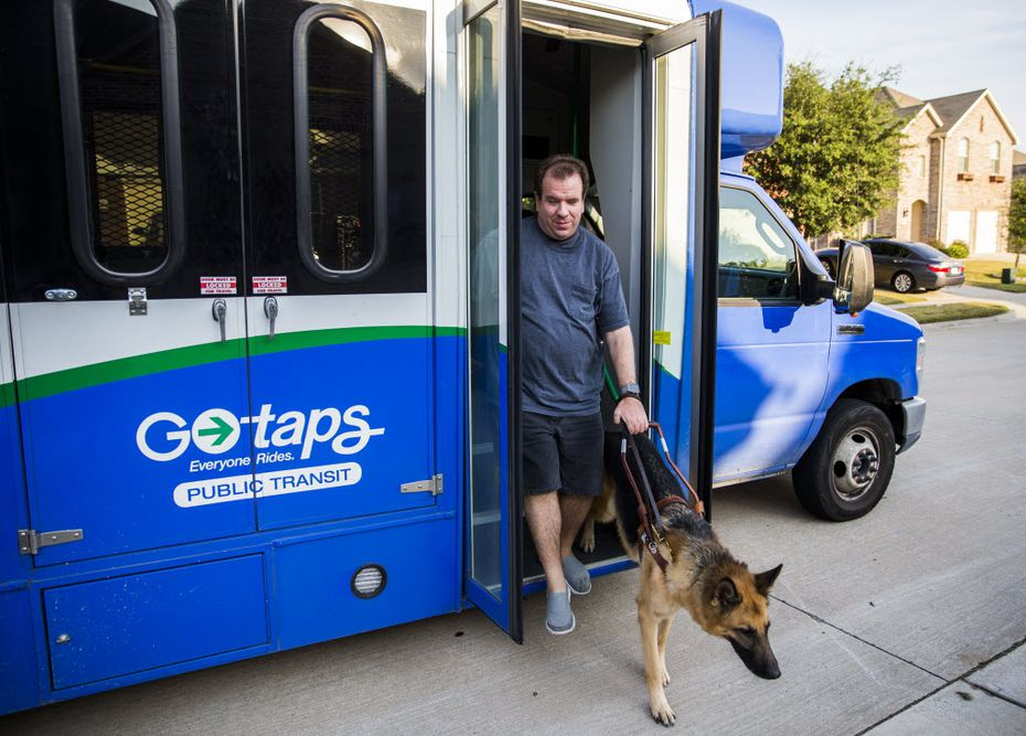 Justin Mann and his guide dog, Garvey, arrived at their McKinney home on a TAPS Public Transit bus on Oct. 8, 2015. (Ashley Landis/The Dallas Morning News)