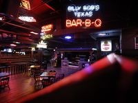 An overall view of the Honky Tonk Kitchen and socially distance dining area at Billy Bob's Texas in Fort Worth, Wednesday, August 5, 2020. Due to a state mandate that bars be closed due to the COVID-19 pandemic, the honky tonk entertainment venue is opening with food service. (Tom Fox/The Dallas Morning News)