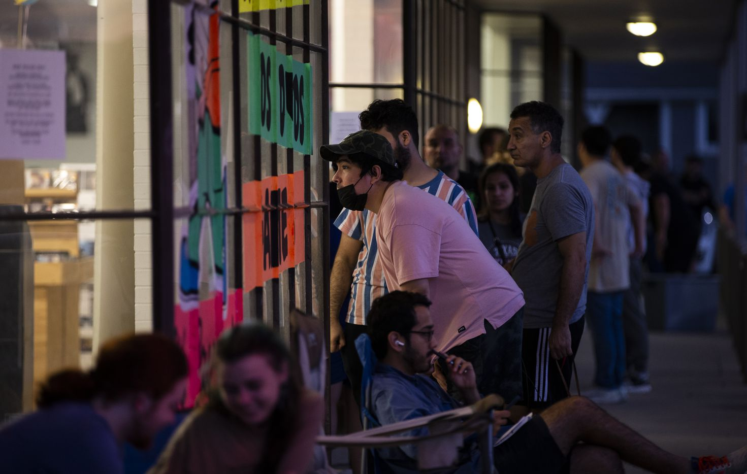 Juan Soto looks through the window at Josey Records early Saturday morning on Record Store Day. Soto waited in line since 11 p.m. Friday for a chance to buy a Lady Gaga album on vinyl.