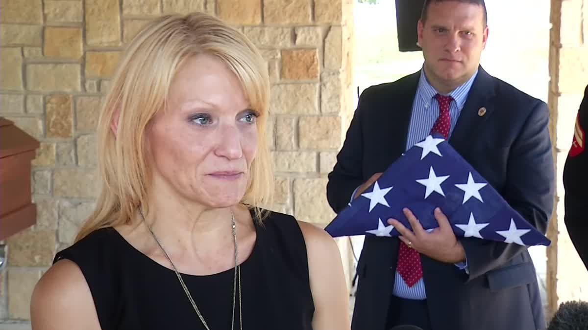 Tiffany McCullers talks to reporters at the burial for her husband, SMU Officer Mark McCullers, on Monday in Dallas.