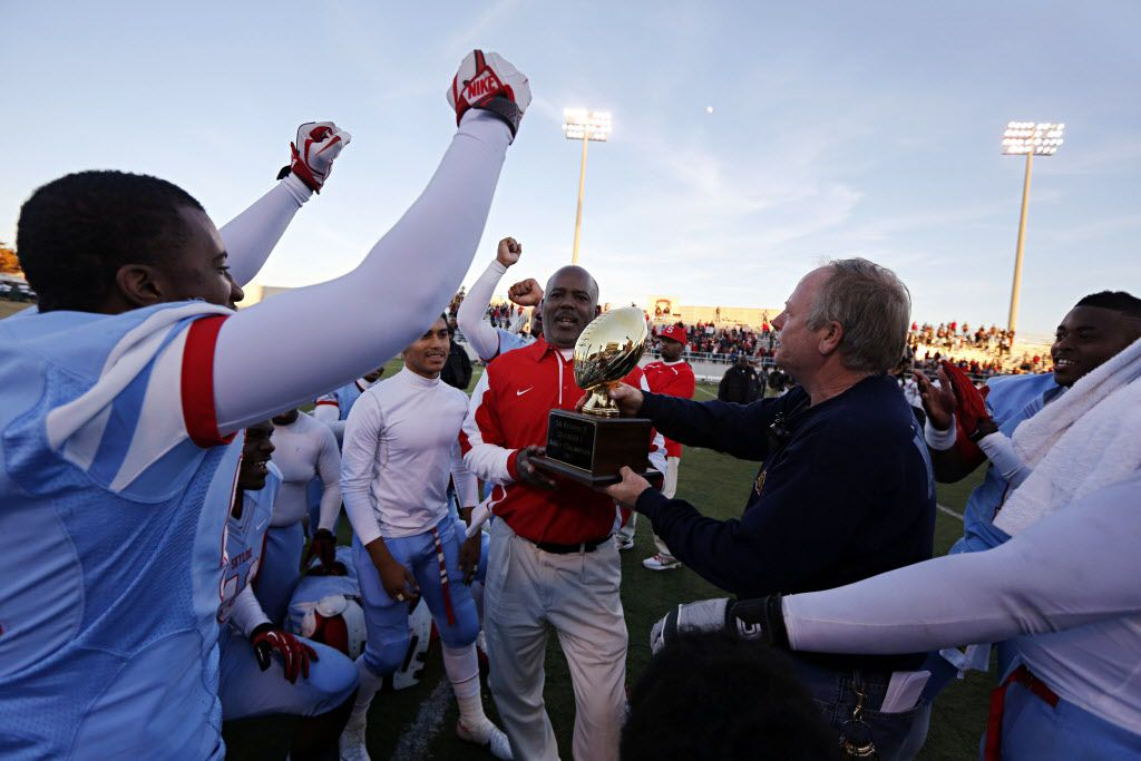 Skyline head coach Reginald Samples and players celebrate their 47-28 Class 5A Division I area-round playoff win over Mesquite Horn Saturday, November 24, 2012 at Wildcat-Ram Stadium in Dallas. (G.J. McCarthy/The Dallas Morning News)